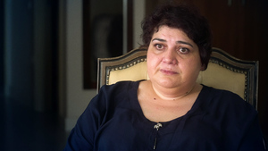 Ismayilova sits in front of a camera